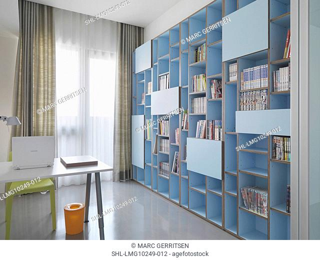 Large bookcase in minimalistic home office