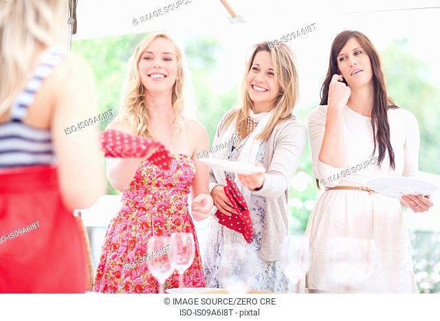 Women setting table outdoors