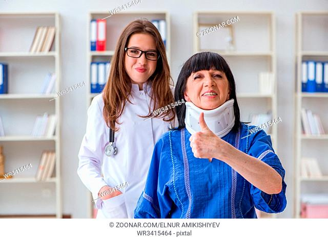 Senior woman with neck injury at doctors