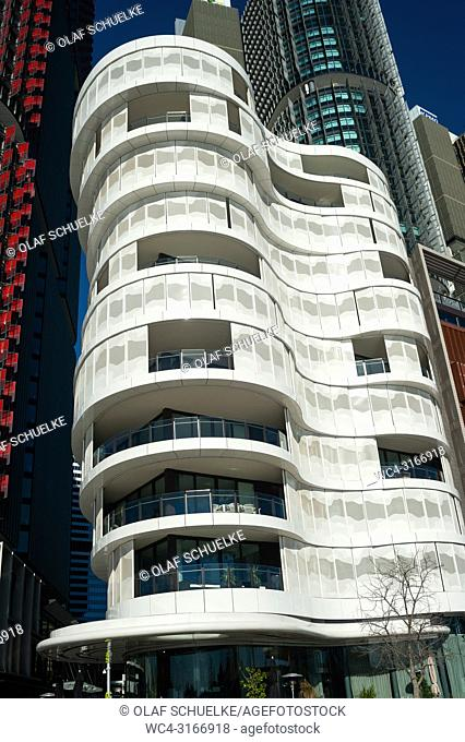 A view of modern residential buildings of the Anadara Residence along the precinct on Wulugul Walk in Barangaroo South facing Darling Harbour