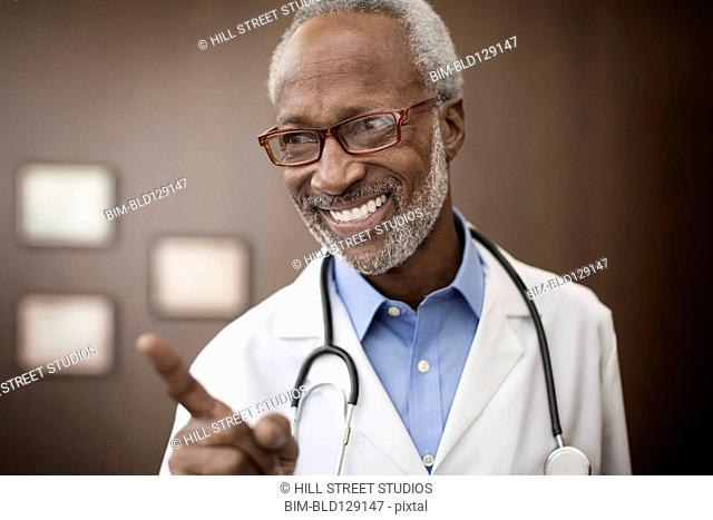 Black doctor smiling in office