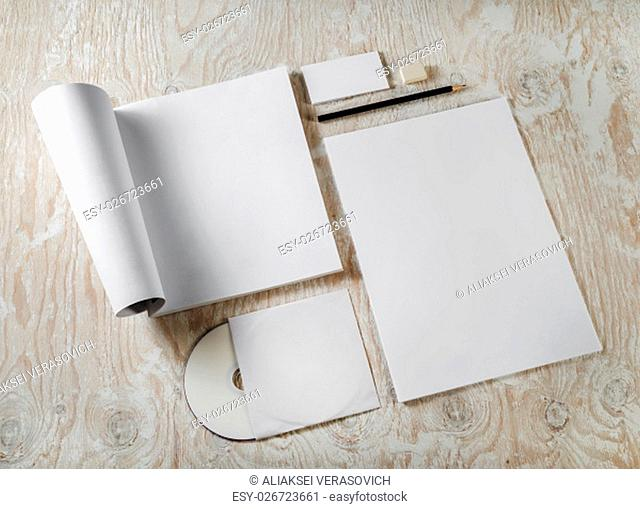 Photo of blank stationery set. Corporate identity on light wooden background. Template for design presentations and portfolios. Top view