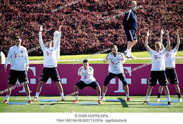Bayern Munich's Niklas Suele (L-R), Marco Friedl, Sandro Wagner, Tom Starke, Felix Goetze and Sebastian Rudy participate in a training session in Doha, Qatar