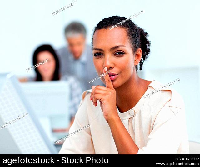 Confident businesswoman asking for silence