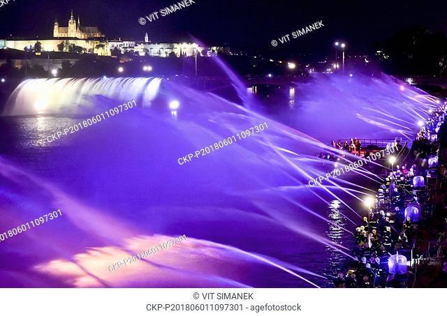 Some 1,000 firefighters from across the country create a musical fountain on the Vltava River (Moldau) in Prague, on Friday, June 1st, 2018