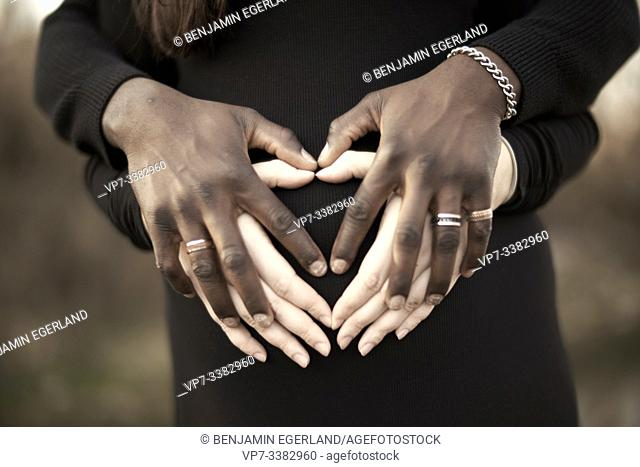 hands of mixed-race lovers
