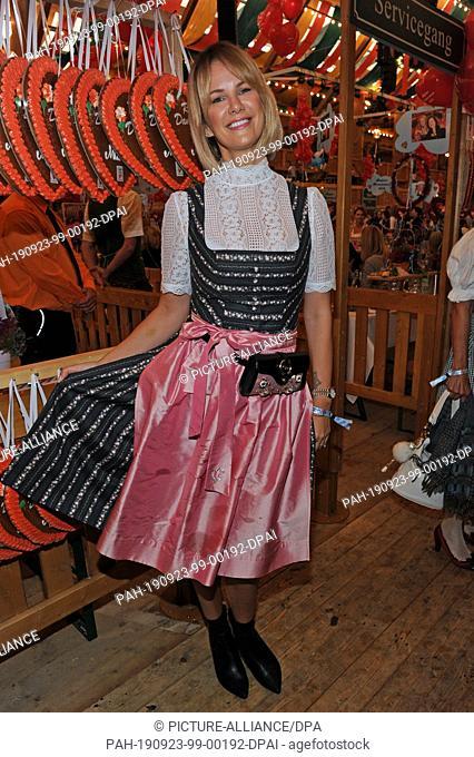 23 September 2019, Bavaria, Munich: Model Monica Ivancan is a guest at the traditional Regine Sixt Ladies' Fair in the Schützen-Festzelt at the Oktoberfest