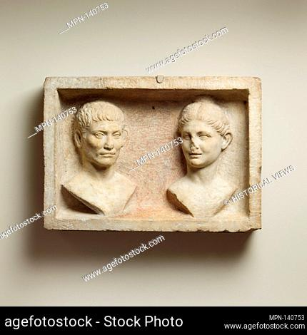 Marble grave relief with two portrait busts. Period: Early Imperial, Augustan; Date: ca. 13 B.C.-A.D. 5; Culture: Roman; Medium: Marble; Dimensions: Overall: 20...