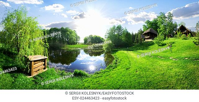 Wooden house near river at sunny day