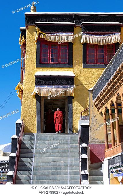 Thiksey Monastery, Indus Valley, Ladakh, India, Asia. Buddhist monk in front of temple entrance