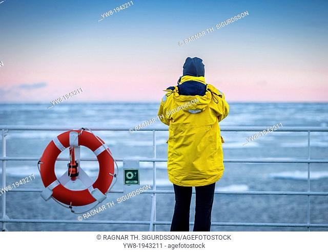 Taking a picture from the deck of the Akademik Sergey Vavilov -Russian ice breaker used as a cruise ship, Greenland