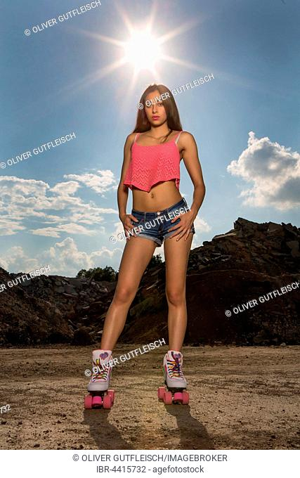 Young woman poses with roller skates