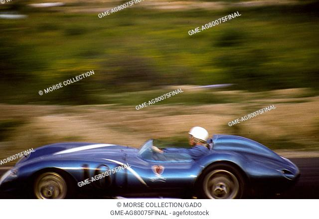 Action view of Mr. Lance Reventlow in his 1958 RAI Scarab-Chevrolet Mk, August 17, 1958. I race car No. 6 or 16, cruising at speed down the track during the...