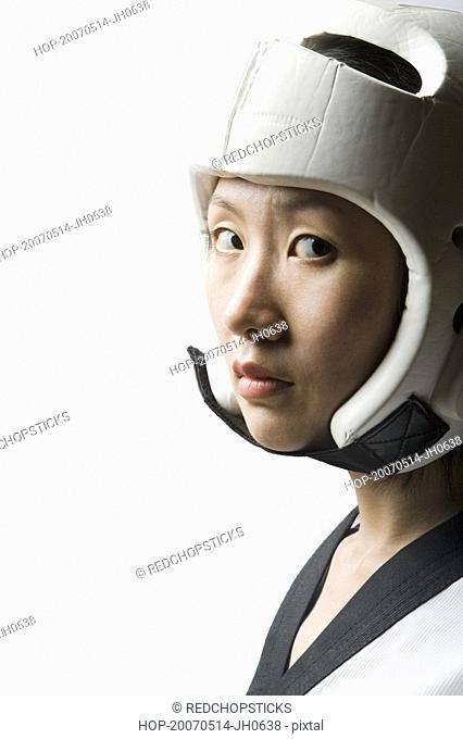 Portrait of a young woman wearing a sports helmet