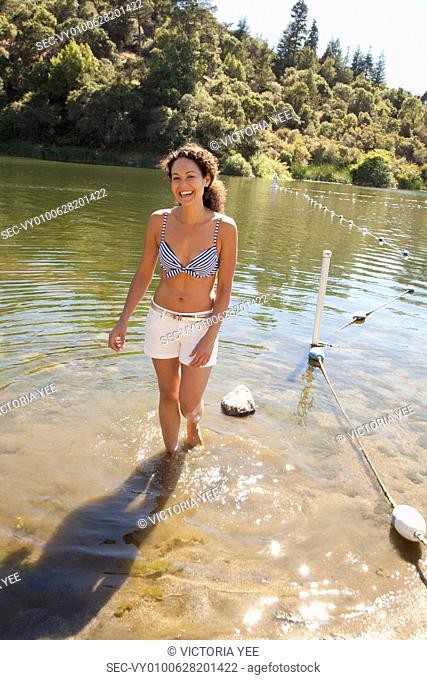 Woman walking out of water