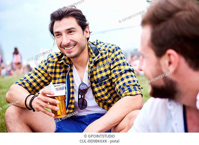 Friends sitting and enjoying music festival