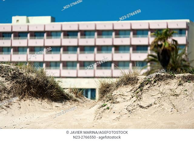 Dunes and buildings on El Saler beach, Valencia, Spain