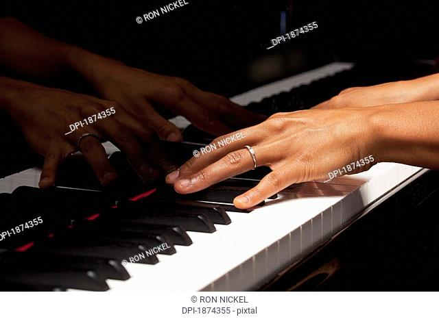 fort lauderdale, florida, united states of america, hands playing the piano