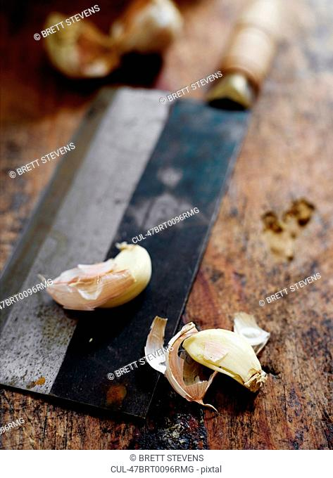 Garlic cloves on butchers knife