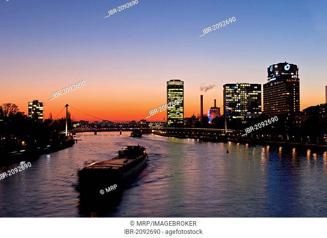 Skyline, Main river at dusk, with ship and bank building, Frankfurt am Main, Hesse, Germany, Europe