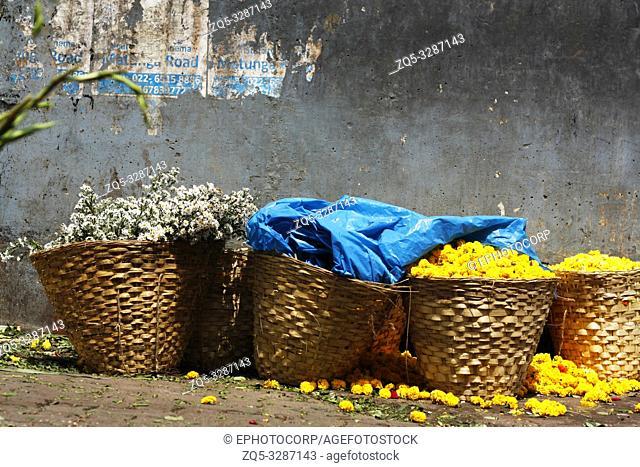Baskets of flowers at Dadar flower market, Mumbai, India