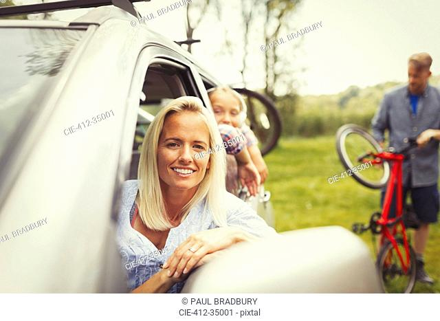 Portrait smiling mother and daughter in car