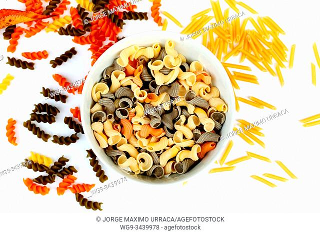 Assorted pasta on white background