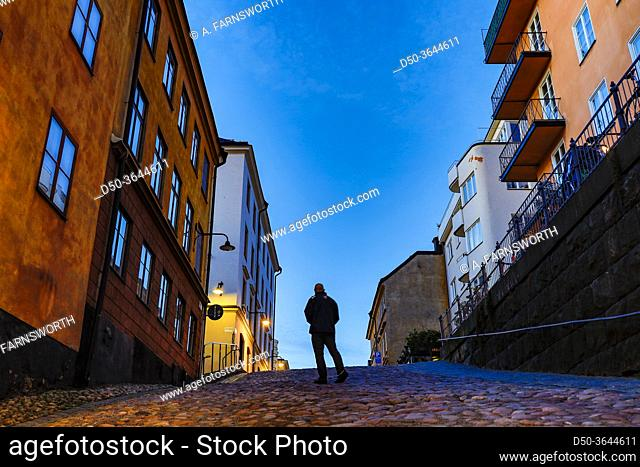 Stockholm, Sweden A man walking on the historic Bellmansgatan in the early morning