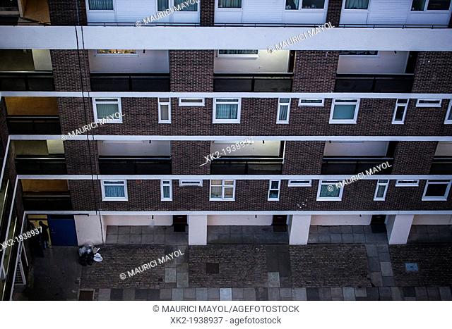 Facade of poor people flats in outskirts, viewed from above, Bermonsey, London, UK