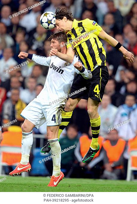 Dortmund's Neven Subotic (R) and Real's Sergio Ramos vie for the ball during the UEFA Champions League semi final second leg soccer match between Borussia...