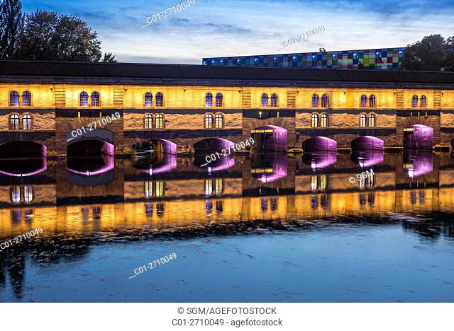 Illuminated Barrage Vauban dam at dusk, La Petite France, Strasbourg, Alsace, France