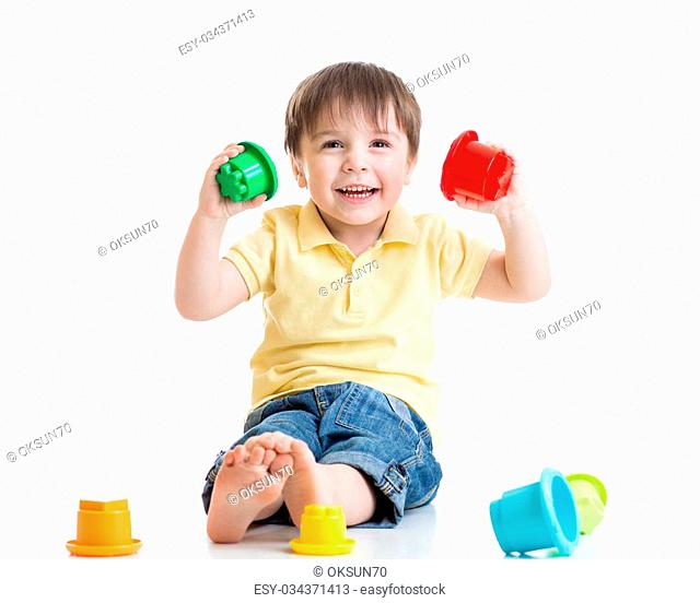 smiling child boy playing with color toys isolated on white