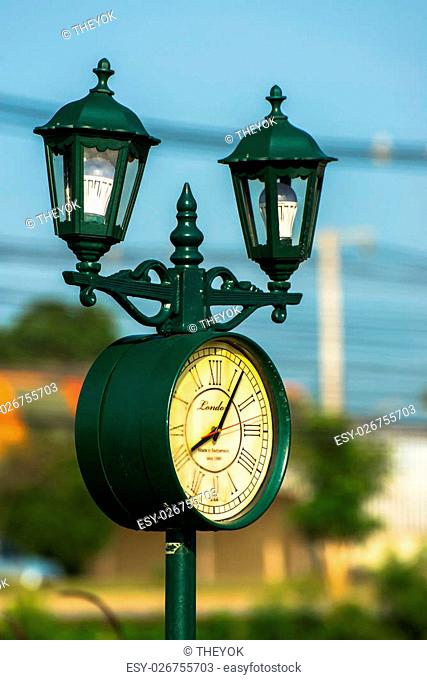 outdoor lamp with the clock as the decoration