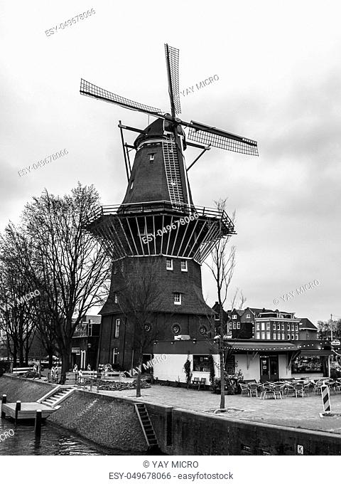 De Gooyer Windmill - old wooden mill in the centre of Amsterdam, Netherlands. Black and white image