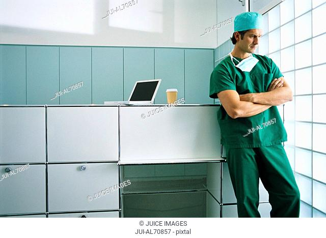 View of a young male surgeon thinking in office setting