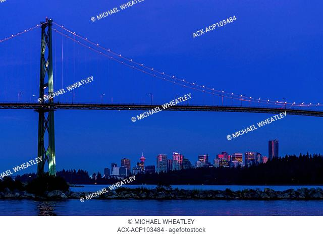Lions Gate Bridge and Vancouver skyline at twilight, , . Vancouver, British Columbia, Canada