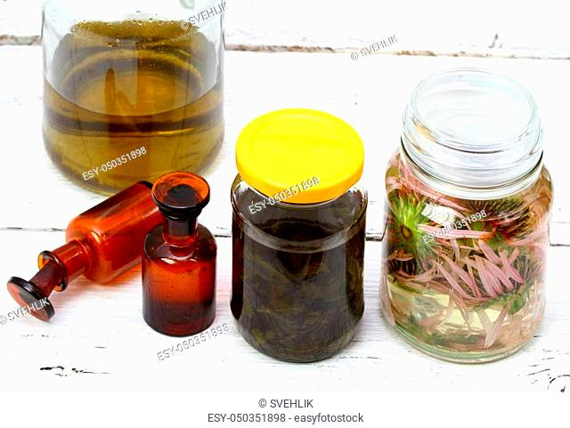 Ready tinctures from herbs and spirit at back