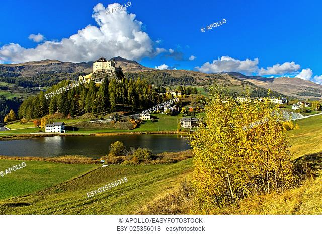 Tarasp Castle rising above lake Taraspsee, Tarasp, Lower Engadin, Graubünden, Grisons, Switzerland