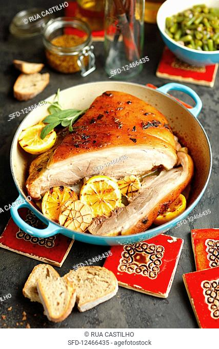 Slow baked pork neck with lemons and sage