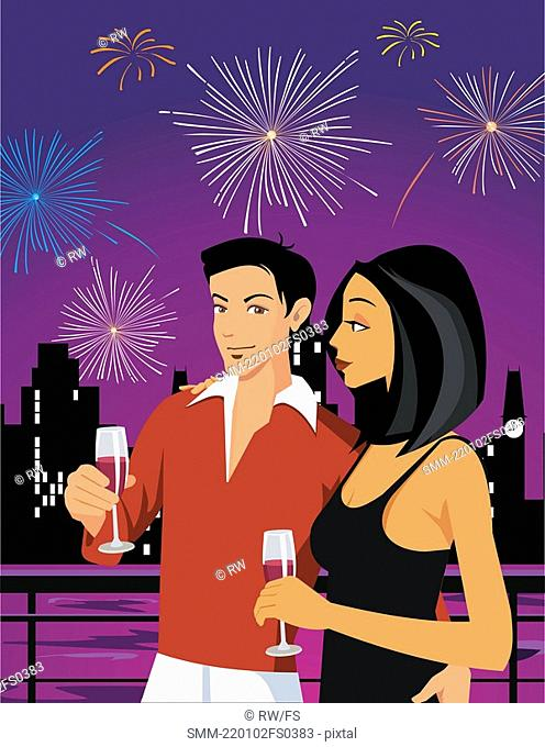 Couple enjoying drink and firework display in the sky
