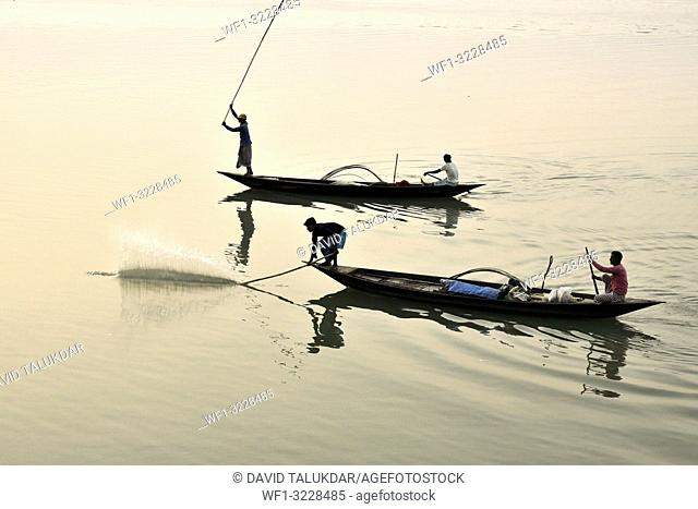 Guwahati, Assam, India. January 30, 2019. Fishermen lays their fishing net at the Brahmaputra River during sunset