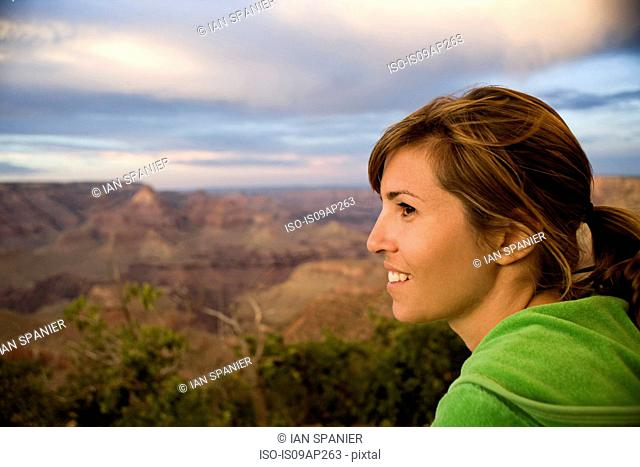 Portrait of female tourist looking out over Grand Canyon, Arizona, USA