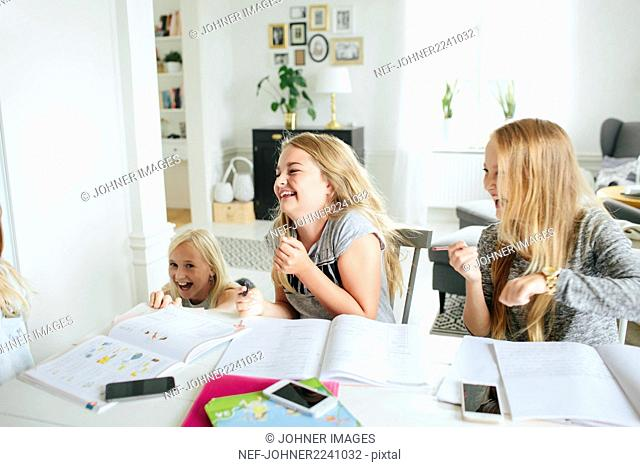 Happy girls learning together