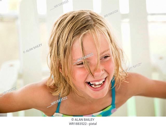 USA, Utah, Orem, Girl (8-9) laughing
