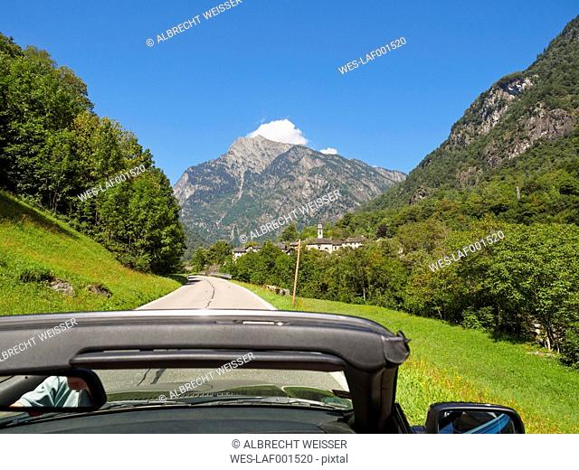 Switzerland, Ticino, Valle Maggia, convertible car on country road
