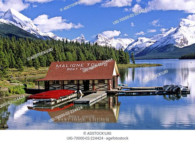 The Boathouse at Maligne Lake with snow capped mountains