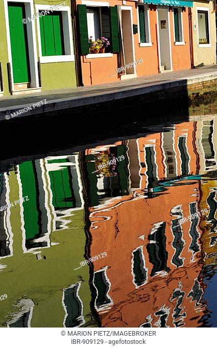 Colourful row houses reflected in water, Burano Island near Venice, Italy, Europe