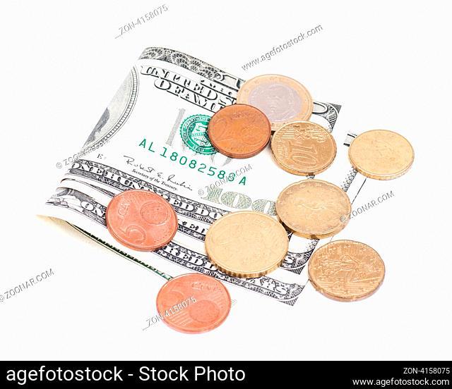 Coins over hundred dollar bills - isolated on white background