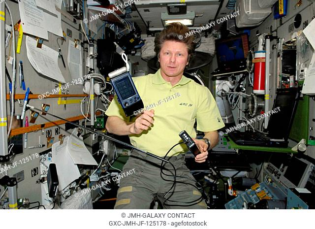 Russian cosmonaut Gennady Padalka, Expedition 20 commander, uses the Russian BAREXPERT science payload to take various environmental measurements in the Zvezda...