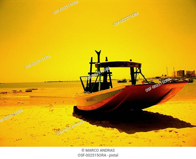 fortaleza sunset light on a boat anchored at the sand